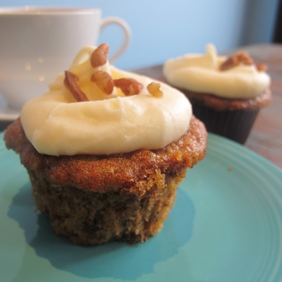 A picture of carrot cupcake with cream cheese frosting.