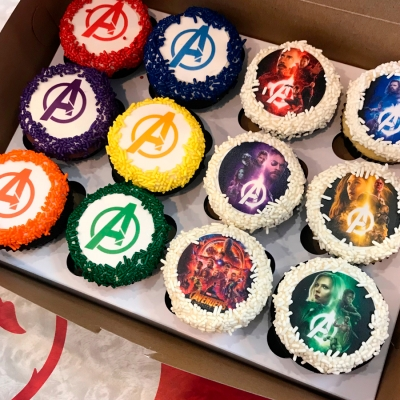 A picture of cupcakes with images on them.